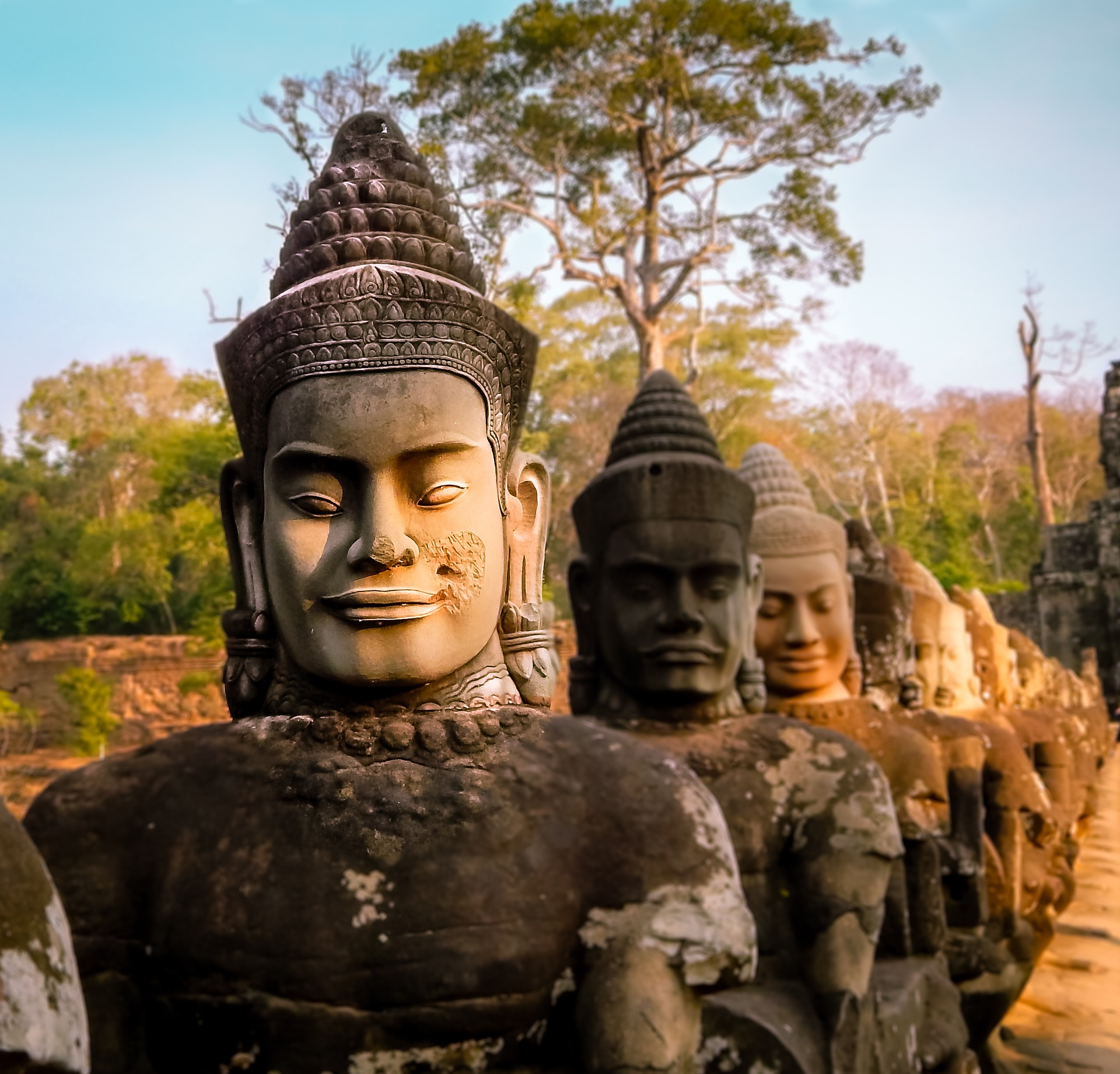 The statues at Angkor Thom, part of the tips for your trip to Cambodia.